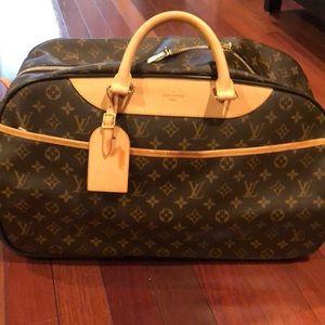 Rare Louis Vuitton EOLE 60 Duffle rolling bag